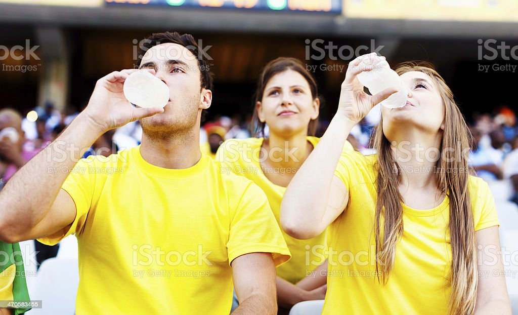 Soccer fans refresh themselves after cheering on the Brazilian team royalty-free stock photo