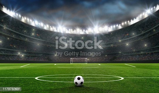 istock soccer field at evening with the bal and soccer goal 1173732631