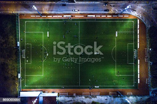istock Soccer field at night - aerial view 869065684