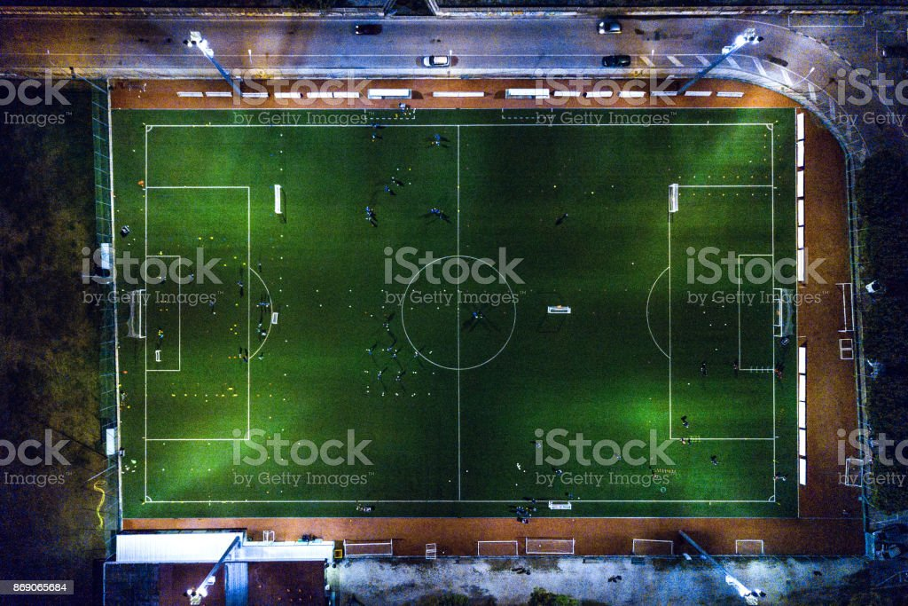 Soccer field at night - aerial view stock photo