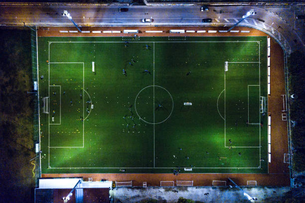 Soccer field at night - aerial view Soccer field at night - aerial view. ultra high definition television stock pictures, royalty-free photos & images