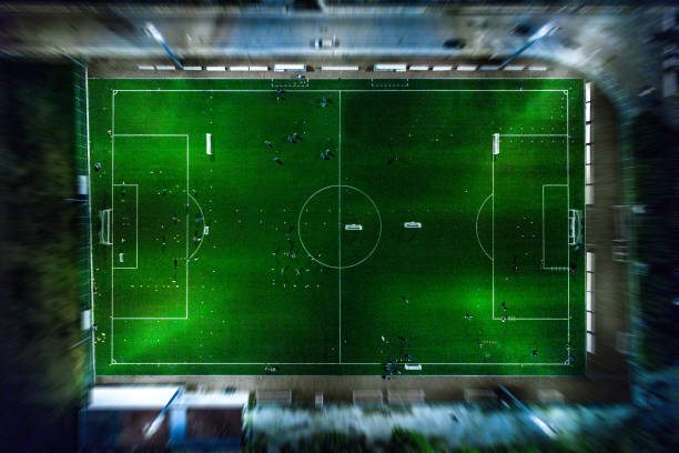 soccer field at night - aerial view - soccer field stock photos and pictures