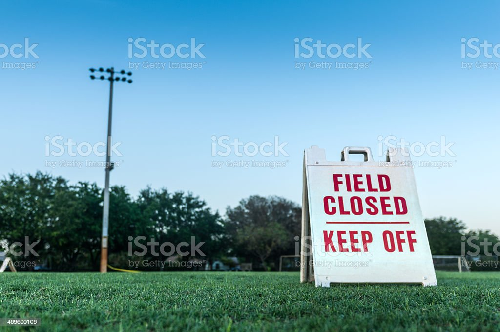 Soccer field closed sign stock photo