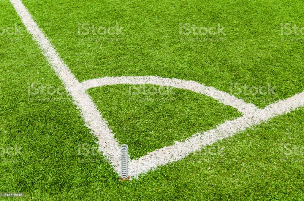 Soccer field corner line on green grass. stock photo