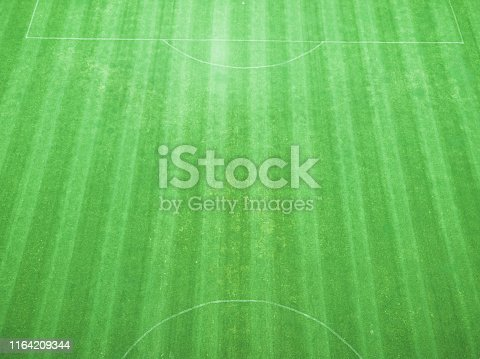 825397576 istock photo soccer field from the drone view 1164209344