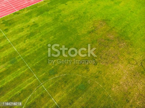 825397576 istock photo soccer field from the drone view 1164216213