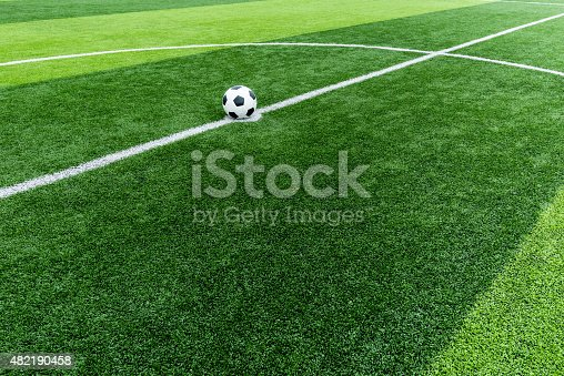 637298374istockphoto soccer field grass with ball at kick off point. 482190458