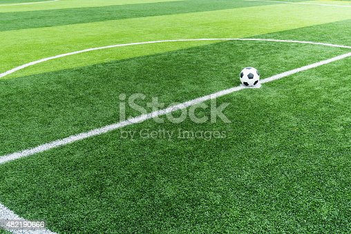 637298374istockphoto soccer field grass with ball at kick off point. 482190666