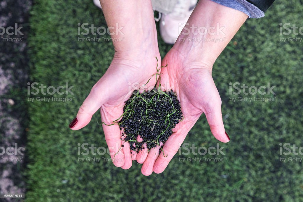 Soccer field made of pieces of synthetic rubber stock photo