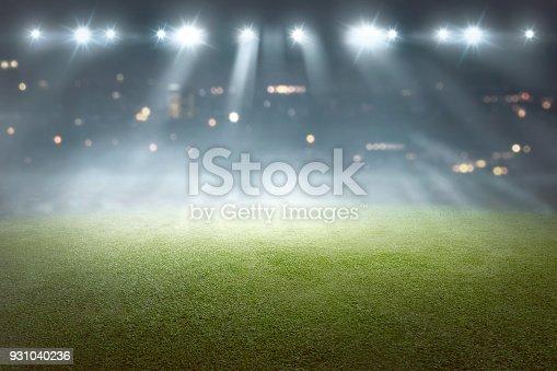 istock Soccer field with blur spotlight 931040236