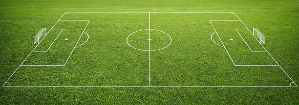 soccer field with goal post - soccer field stock photos and pictures