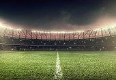 soccer field with illumination and night sky