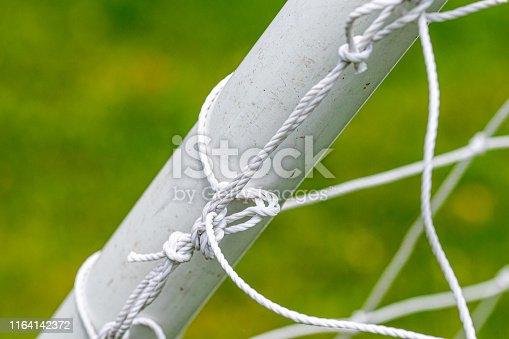 931661614istockphoto Soccer football goal netting 1164142372