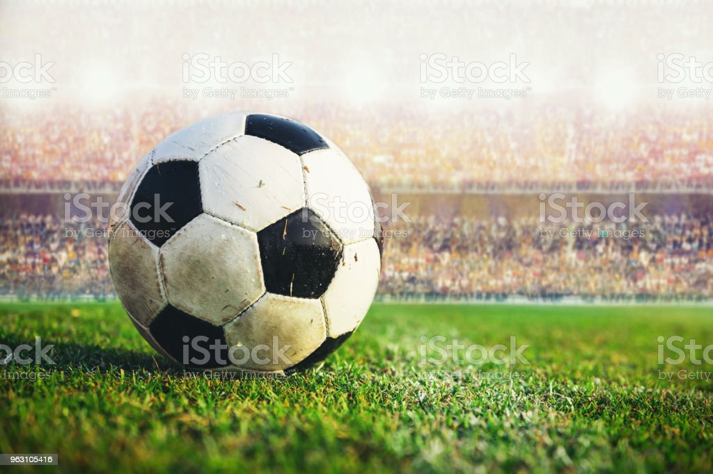 soccer football in the stadium crowd stock photo