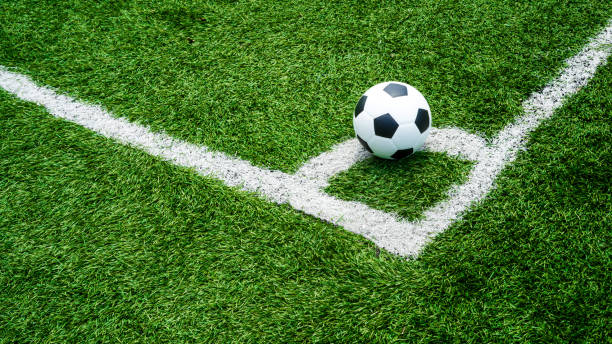soccer Football on Corner kick line of ball and a soccer field , football field , background texture stock photo