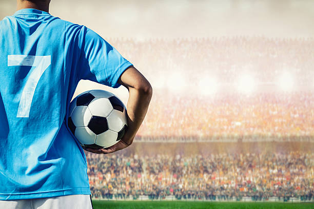 soccer football player in blue team concept holding soccer ball - sports uniform stock photos and pictures