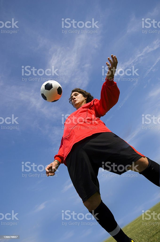 Soccer Football Player in red controlling ball royalty-free stock photo