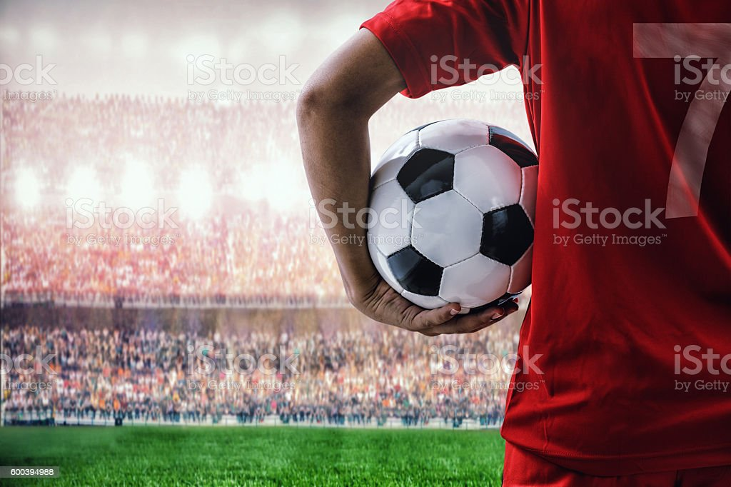 soccer football player in red team concept holding soccer ball stock photo