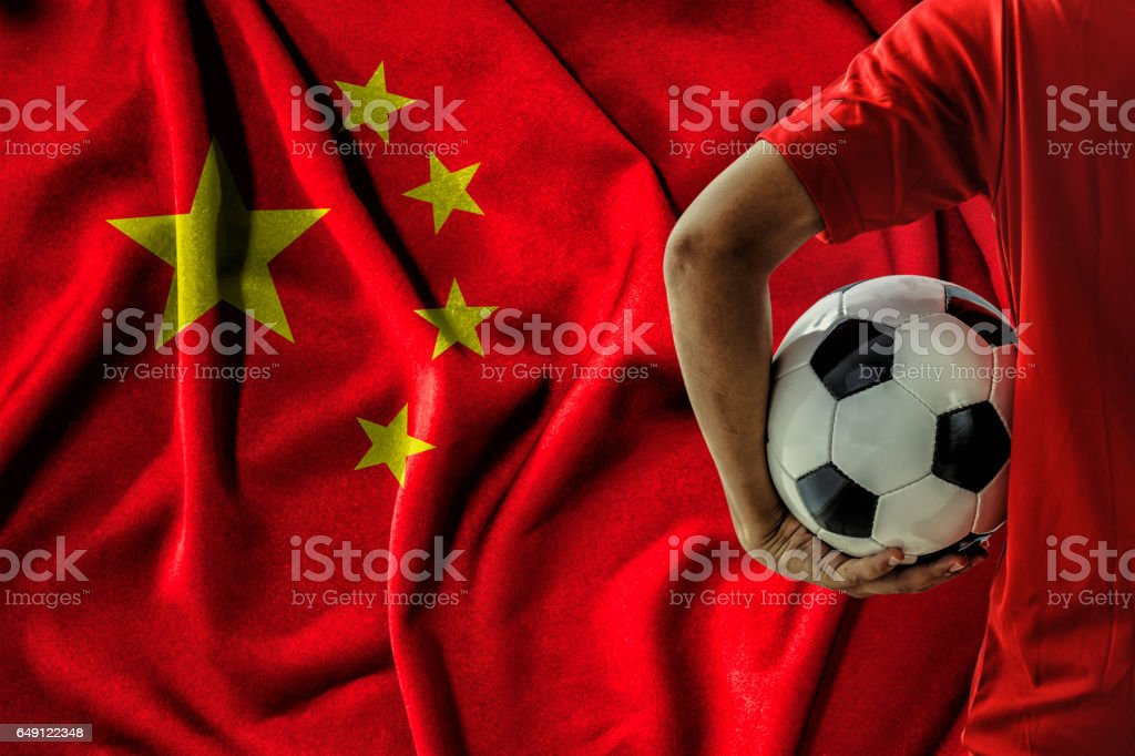 soccer football player on china flag background stock photo