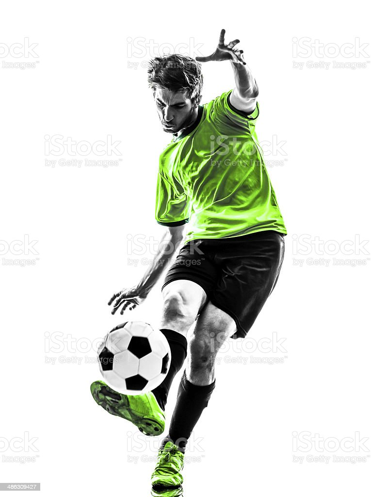 soccer football player young man kicking silhouette stock photo