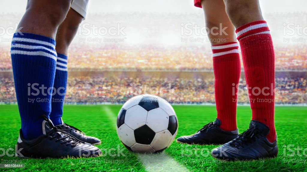 soccer football standing for start kick off the game in the stadium