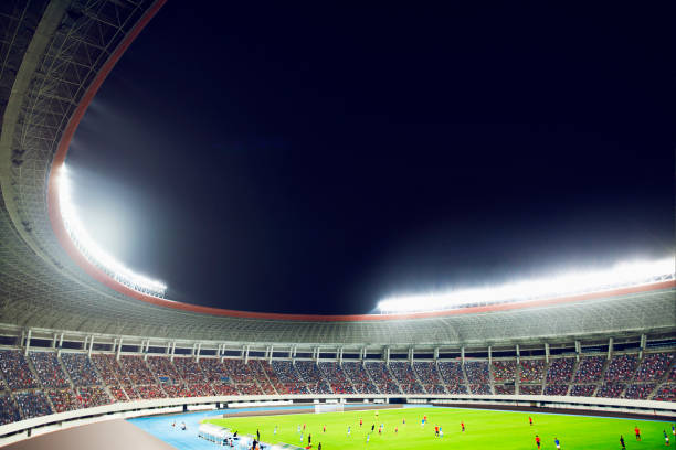 soccer game in a stadium at night - soccer competition stock photos and pictures