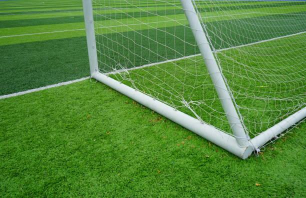 Soccer gate on grass stock photo