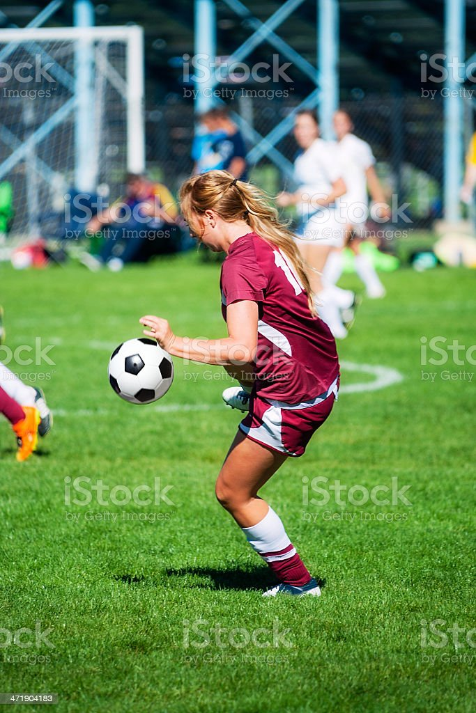 Soccer Girl Pre-Trapping Ball royalty-free stock photo