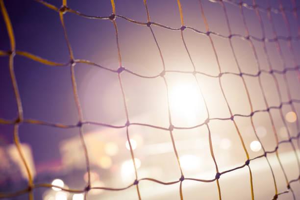 voetbal doel bij nacht - soccer goal stockfoto's en -beelden