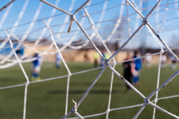Soccer goal net against blurred background stock photo