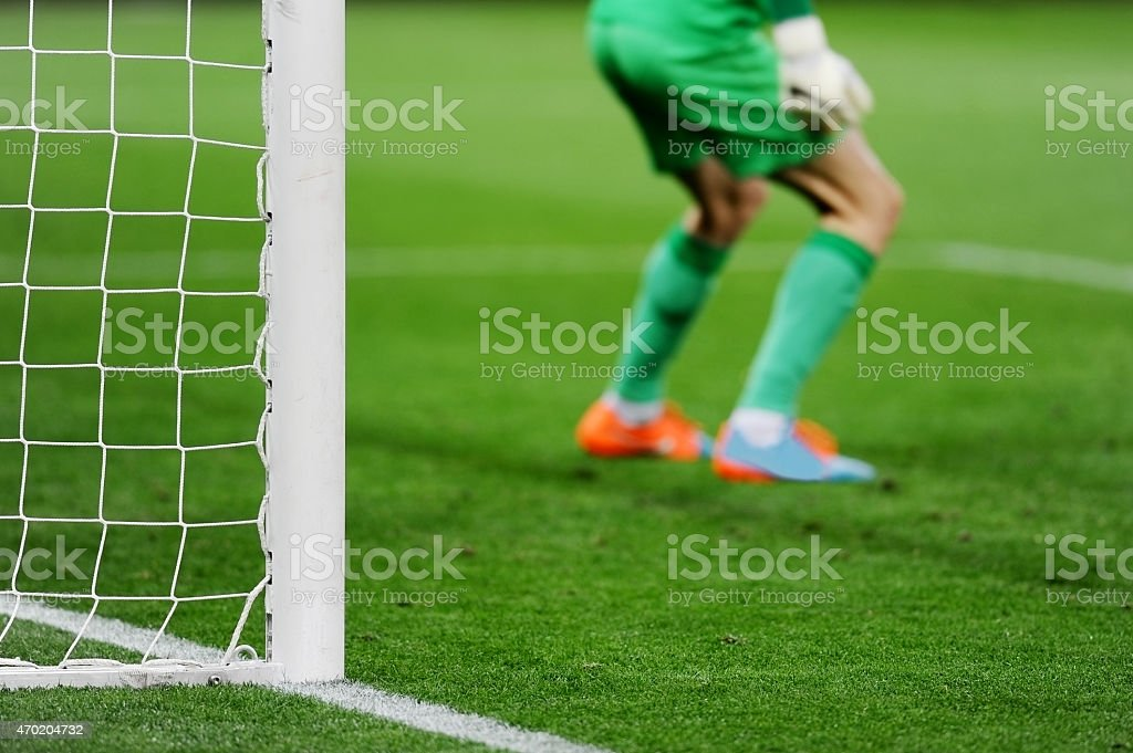 Soccer goal with goalkeeper in background stock photo