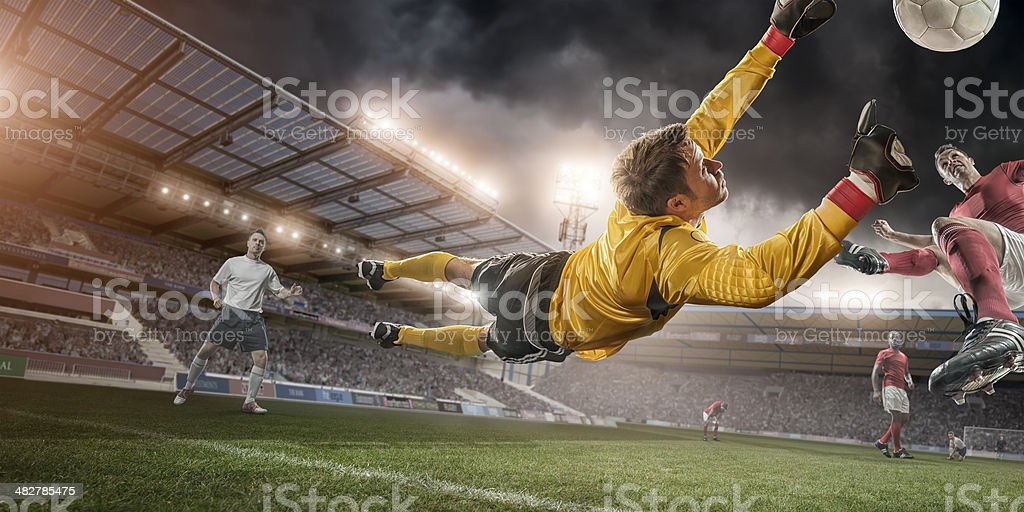 Soccer Goalie in Mid Air Save stock photo