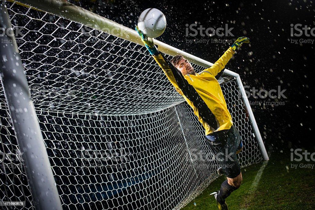 Soccer Goalie Jumping For Ball stock photo