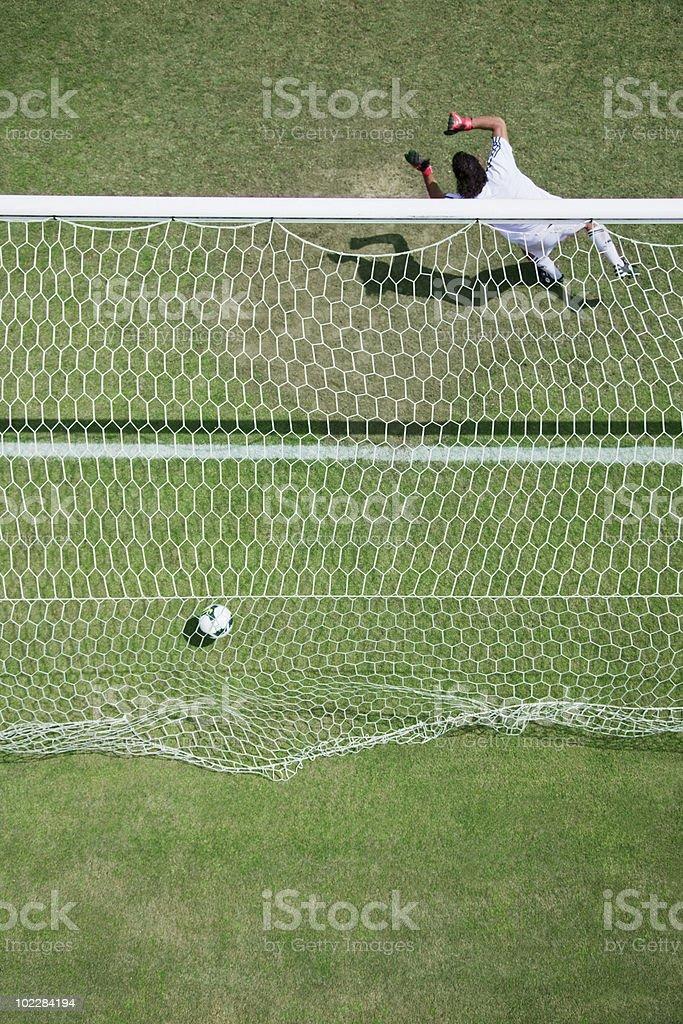 Soccer goalie missing soccer ball stock photo