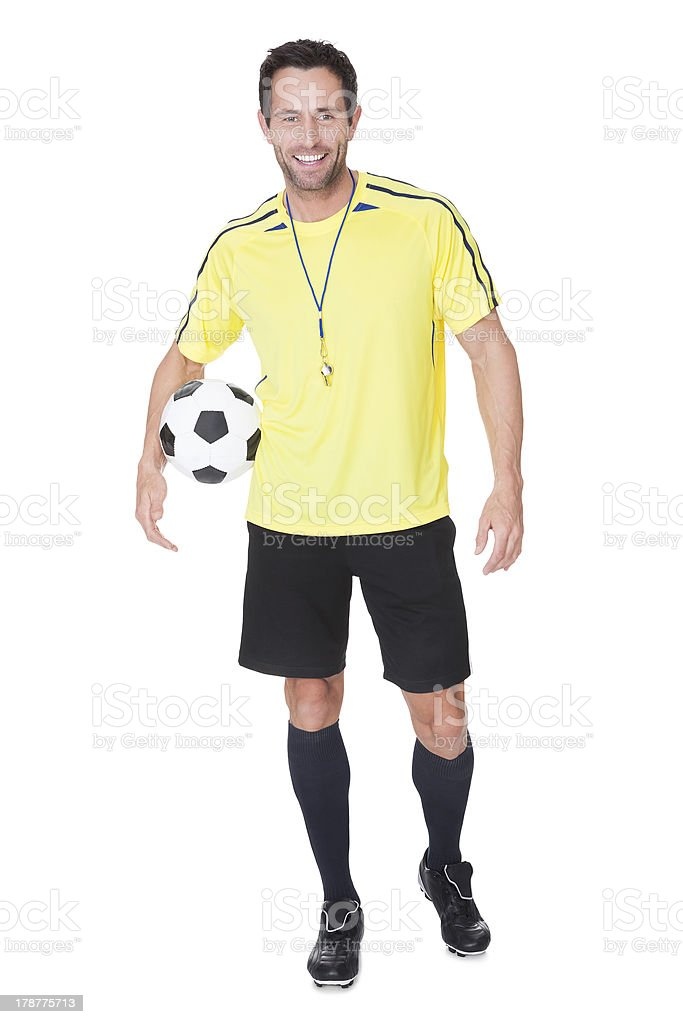 Soccer judge standing with ball royalty-free stock photo