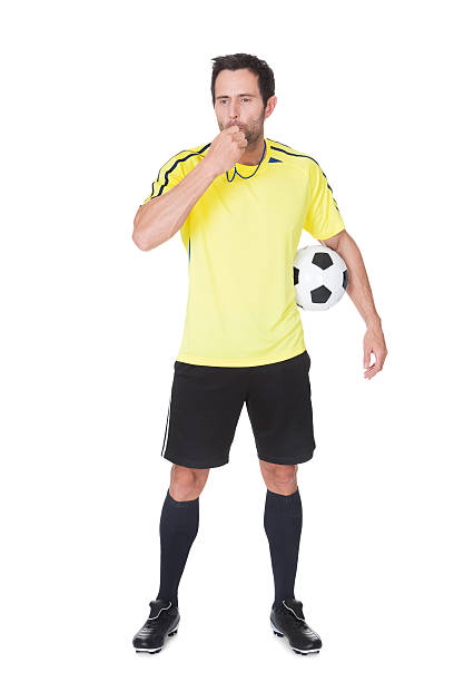 soccer judge standing with ball - judge sports official stock photos and pictures