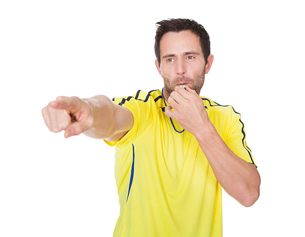 soccer judge whistling - judge sports official stock photos and pictures