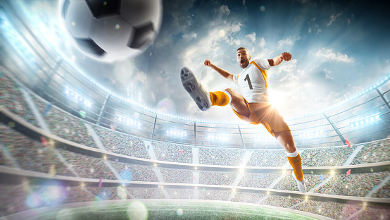 Soccer kick. A soccer player kicks the ball in air fashion. Professional soccer player in action. Stadium with flashlights and fans. 3d. Sport