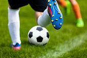 istock Soccer Kick. Footballer Kicking Ball on Grass Pitch. Football Soccer Player Hits a Ball. Soccer Boots Close Up 956352788
