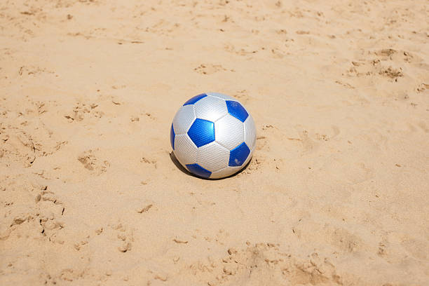 soccer leather ball on beach stock photo