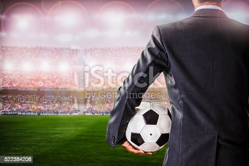 istock soccer manager against supporters in the stadium 522384208