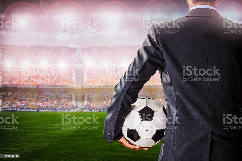 soccer manager against supporters in the stadium stock photo