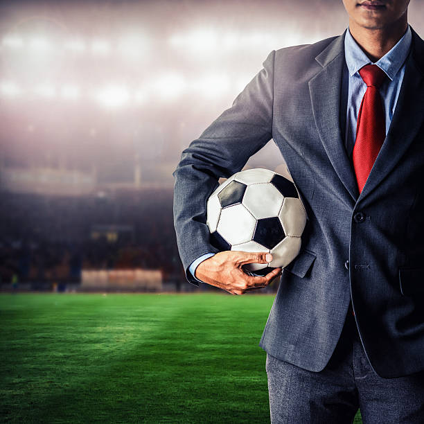 soccer manager holding football – Foto