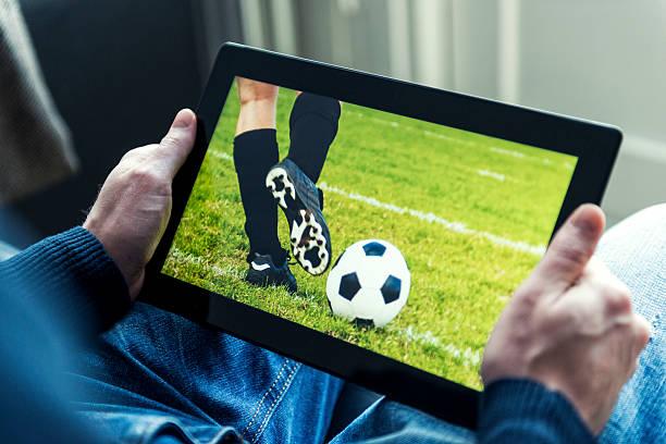 Soccer match live on a digital tablet stock photo