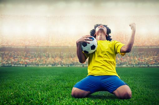 soccer or football player celebrating goal