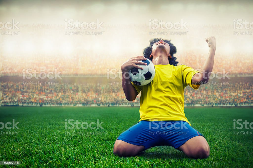 soccer or football player celebrating goal - foto de stock