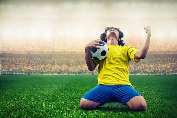 soccer or football player celebrating goal - foto de acervo