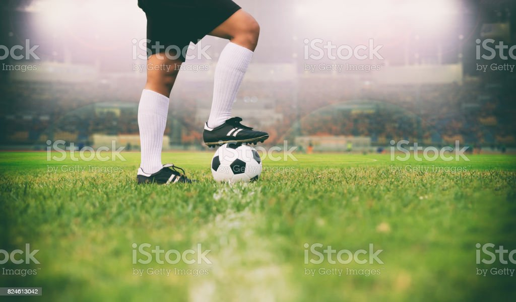 soccer or football player standing with ball on the field for Kick the soccer ball soft focus and selective focus on grass stock photo