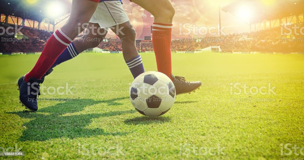 Soccer Or Football Player Standing With Ball On The Field For Kick At