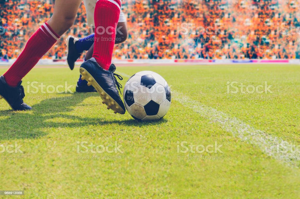 soccer or football player standing with ball on the field for Kick...